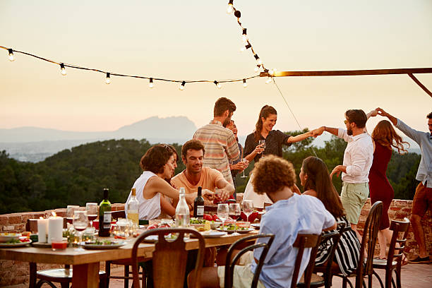 friends enjoying at patio during social gathering - spanish food stock photos and pictures