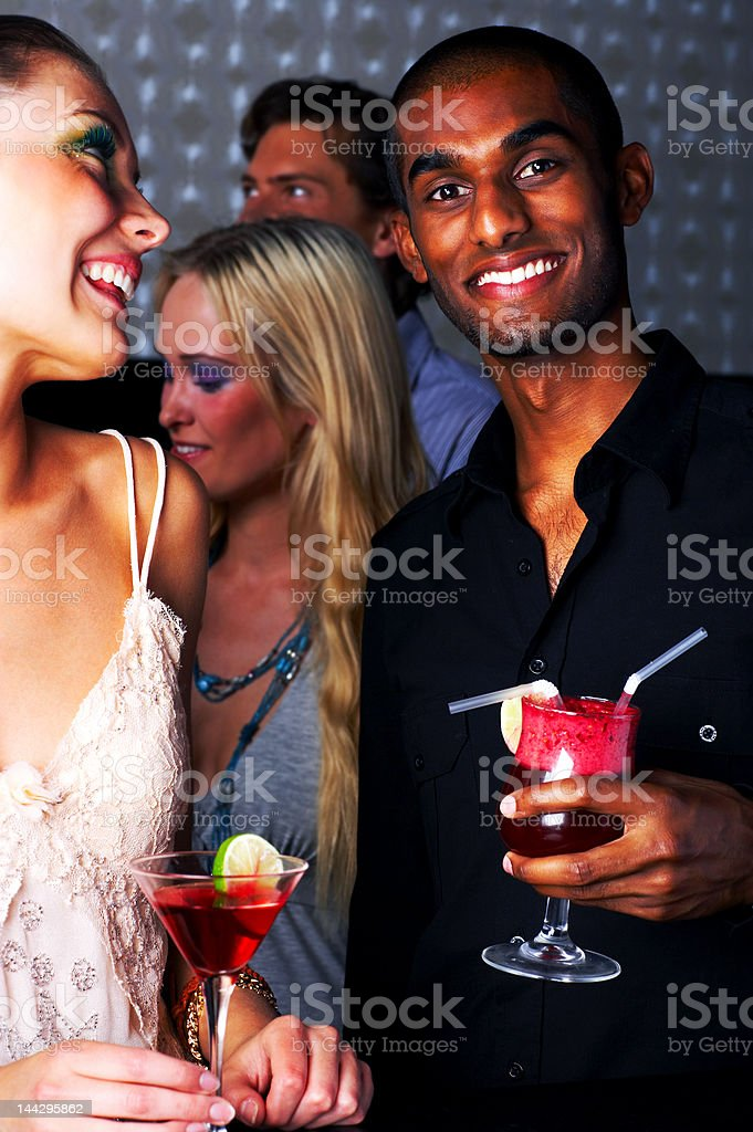 Friends enjoying cocktail party royalty-free stock photo