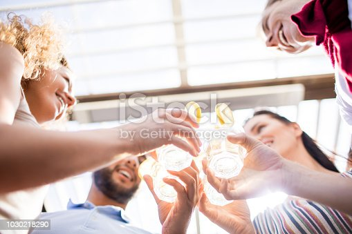 istock Friends Enjoying Cocktails at Party 1030218290