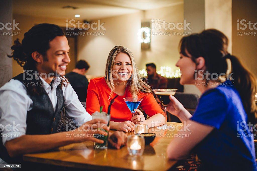 Friends Enjoying Cocktails stock photo