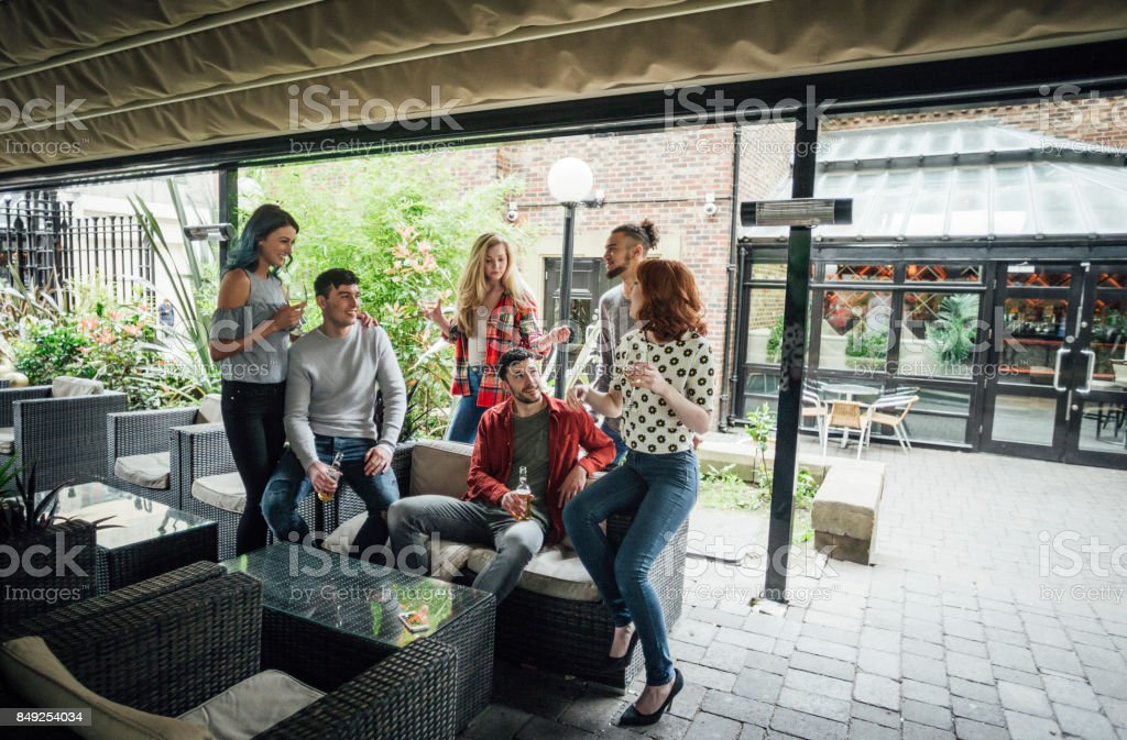 Friends Enjoying Drinks Together stock photo