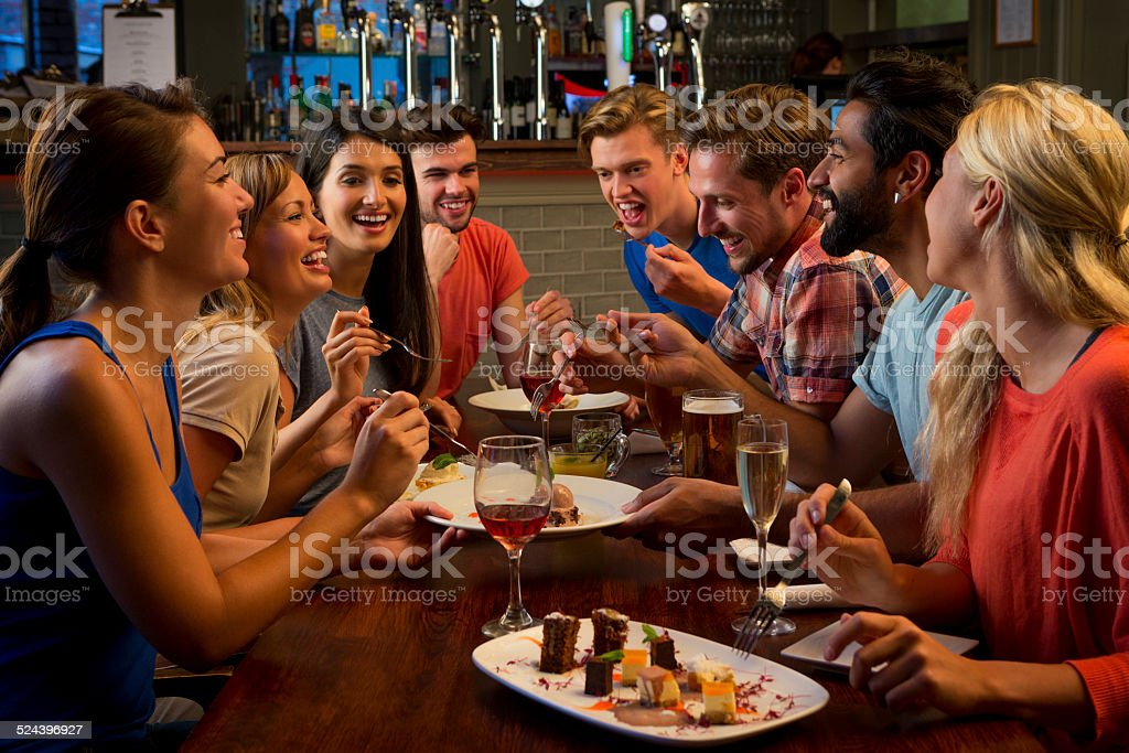 Friends Enjoying Food and Drink stock photo