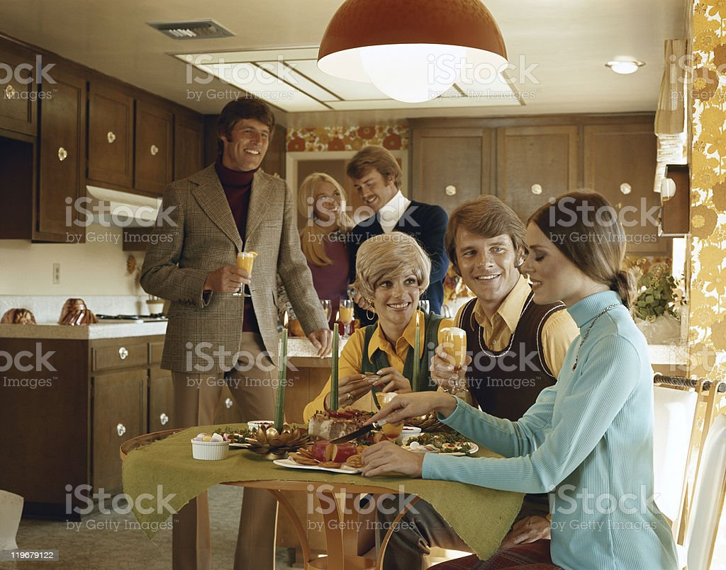 Friends enjoying food party in kitchen stock photo
