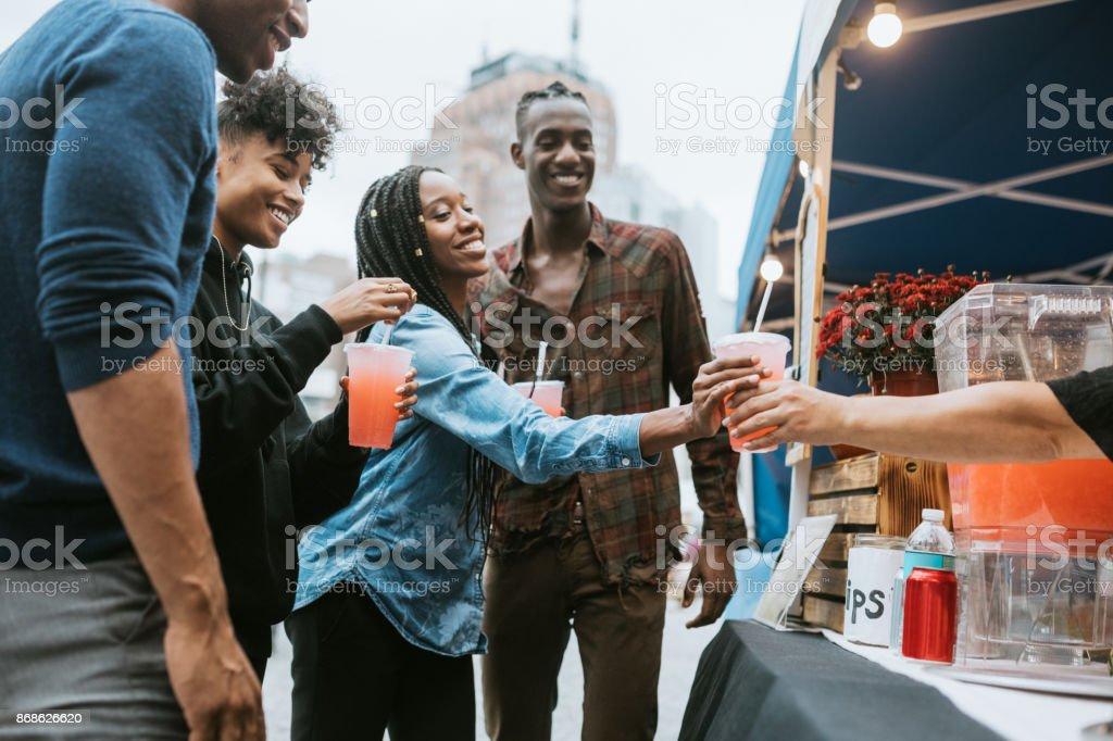 Friends Enjoying Food Truck Life in New York stock photo