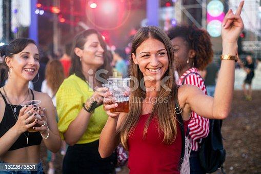 istock Friends enjoying in summer outdoor music festival 1322673831