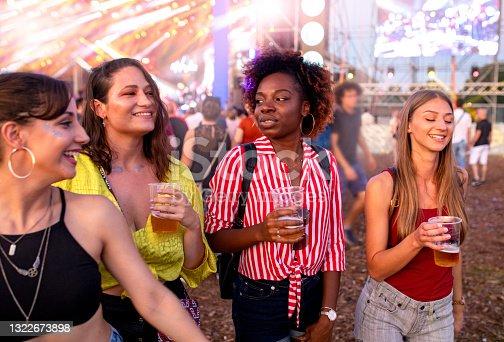 istock Friends enjoying in summer outdoor music festival 1322673898