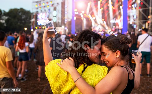 istock Friends enjoying in summer outdoor music festival 1322673914