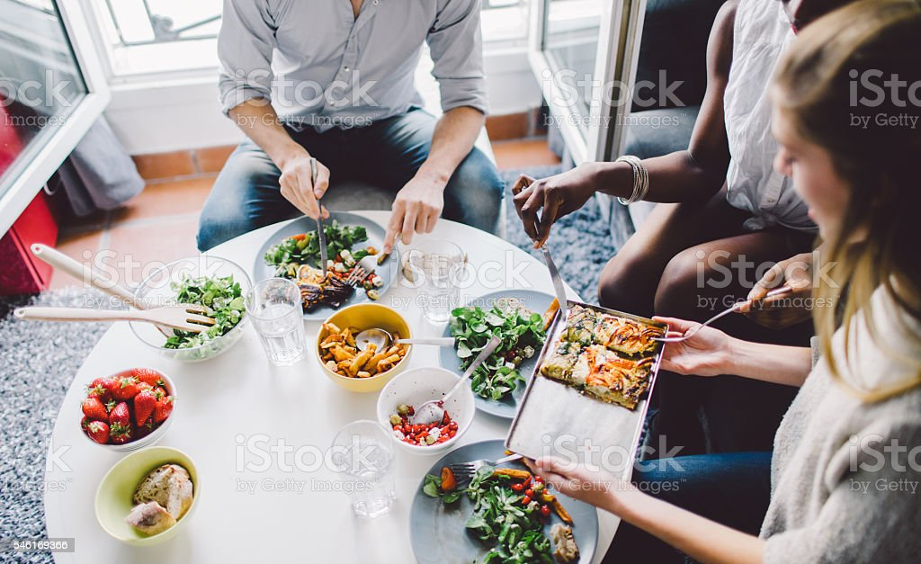 Friends enjoying lunch at home stock photo