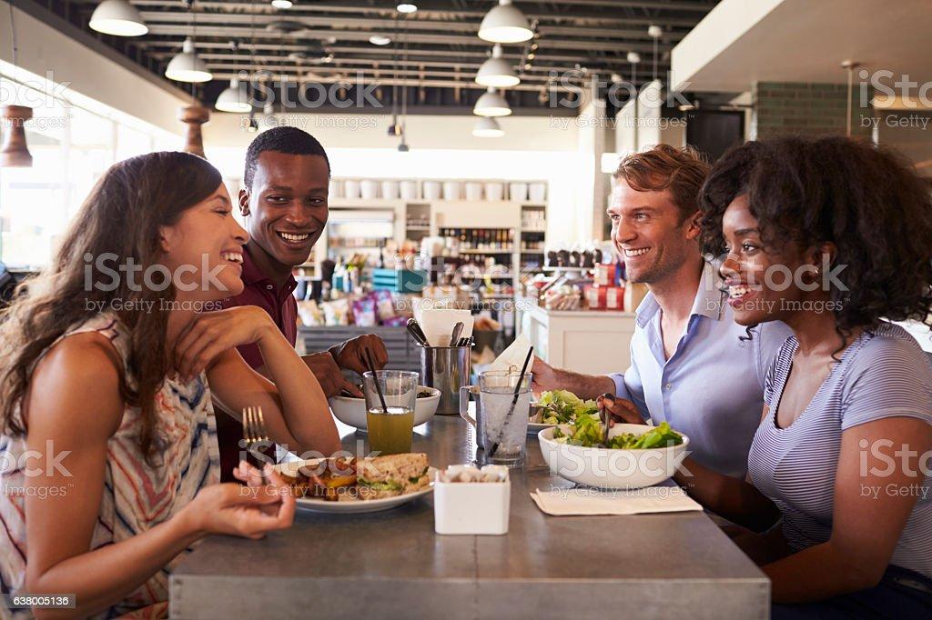 Friends Enjoying Lunch Date In Delicatessen Restaurant - Photo