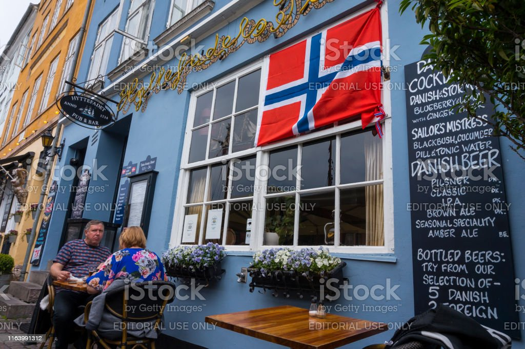 Summertime in the fantastic city of Copenhagen. Iconic Nyhavn with...