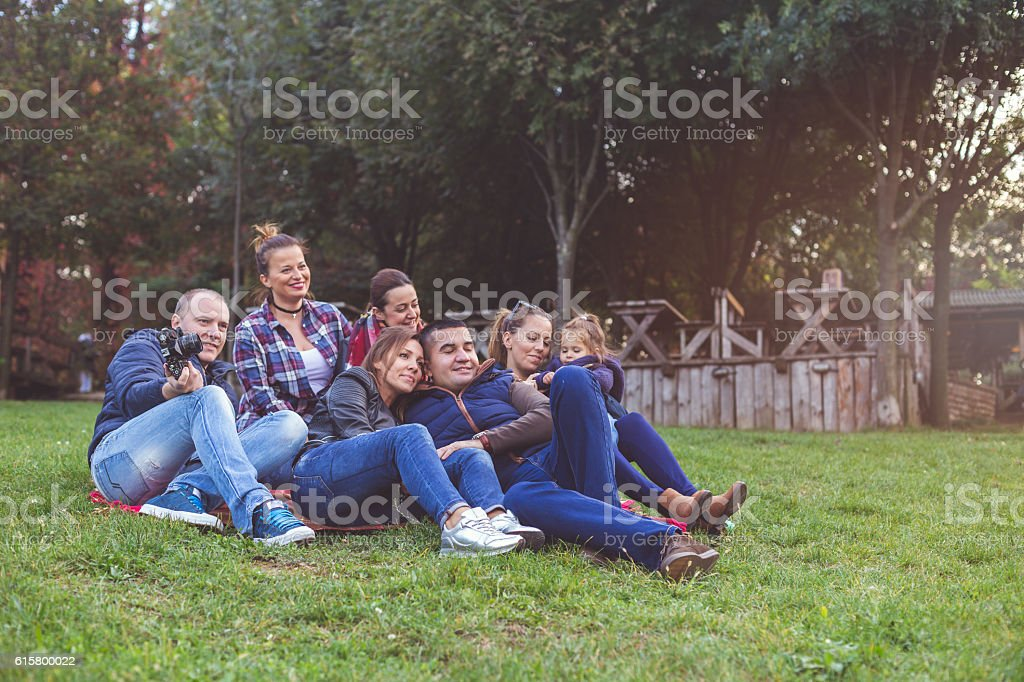 friends enjoying outside - big family stock photo