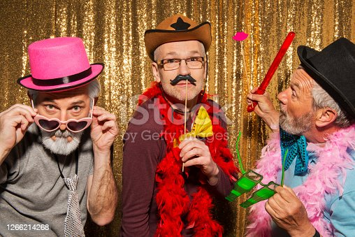 Senior friends wearing props during the party.