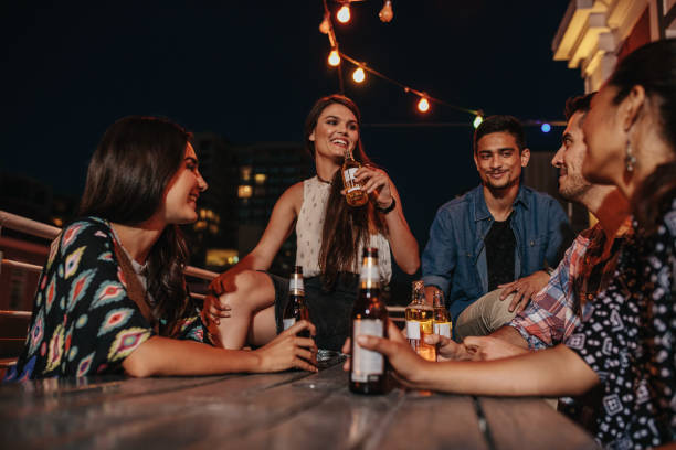 Friends enjoying party with drinks stock photo