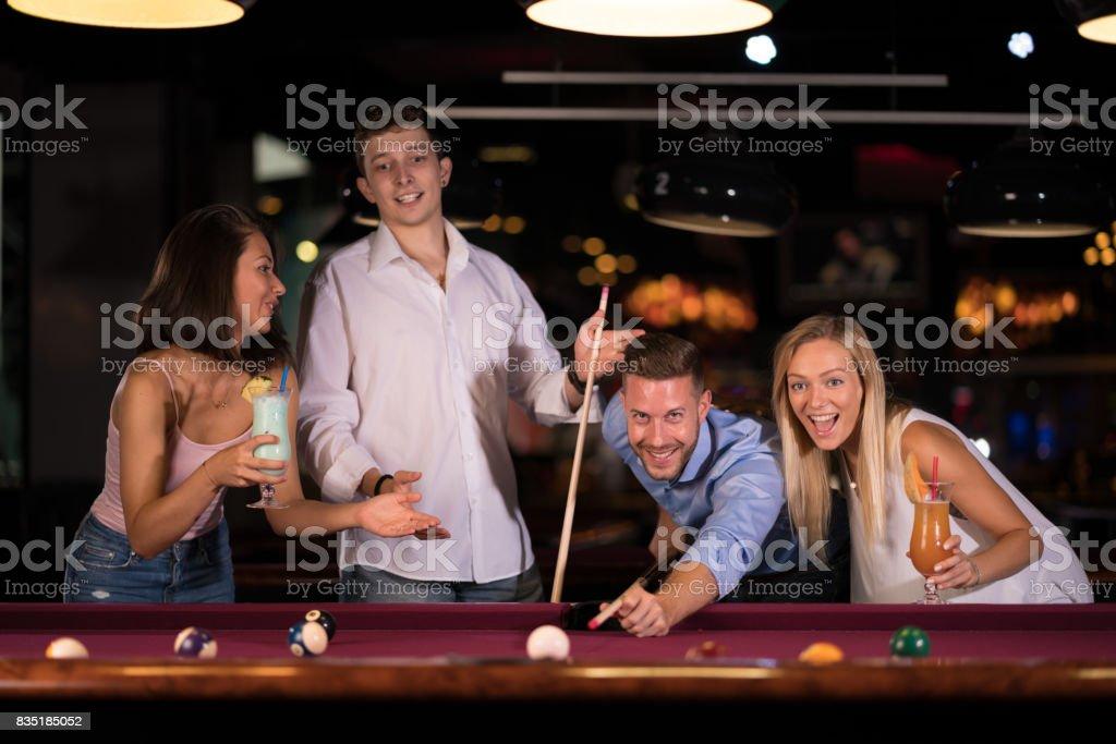 friends enjoying pool game