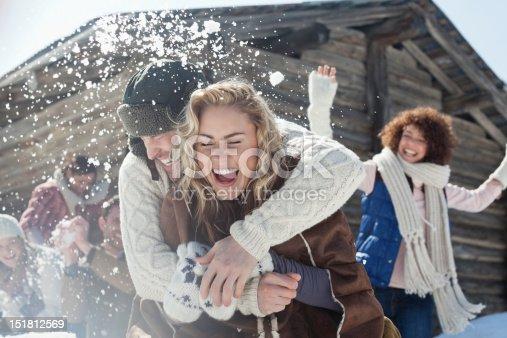 istock Friends enjoying snowball fight 151812569