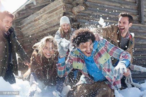 istock Friends enjoying snowball fight 151812647