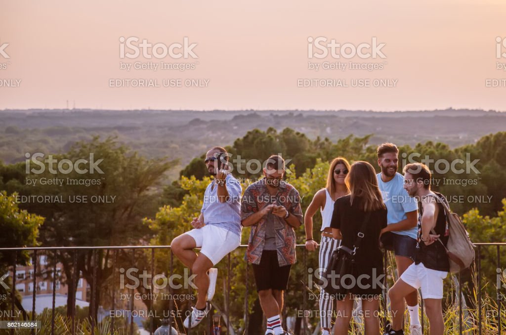 Friends Enjoying Sunset at the Temple of Debod in Madrid,Spain. stock photo