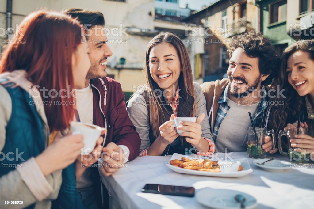 Friends enjoying the warm weather outdoors stock photo