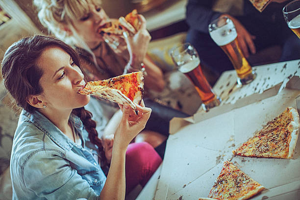 Image result for nigerian ladyeating pizza with friends