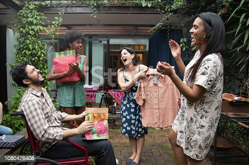 istock Friends Exchanging Presents at get-together barbecue party 1080426408