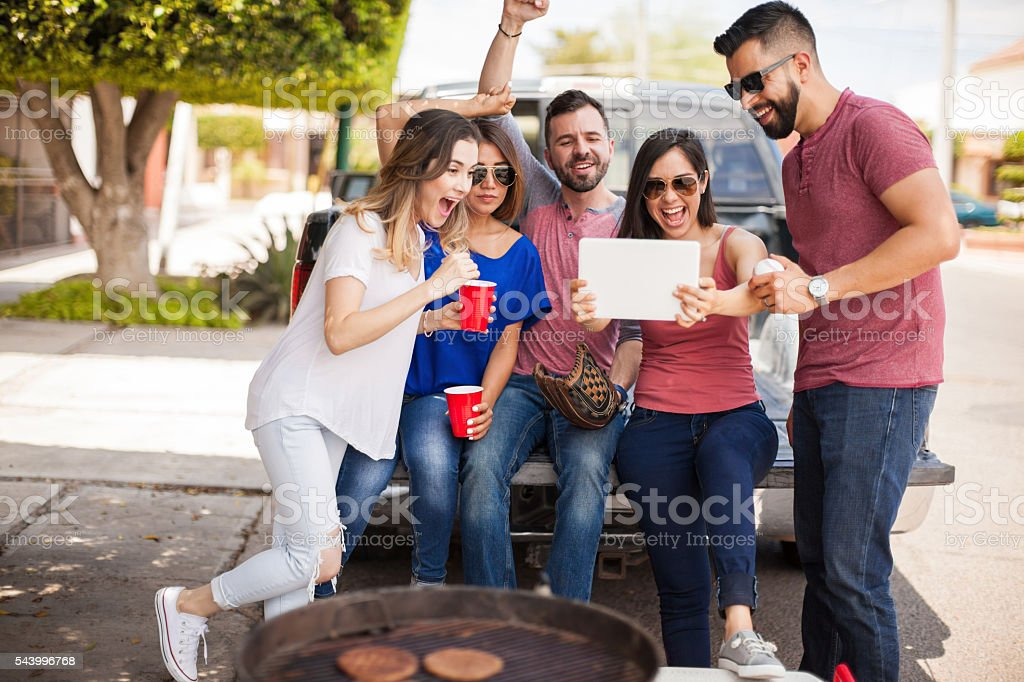 Friends excited about baseball stock photo