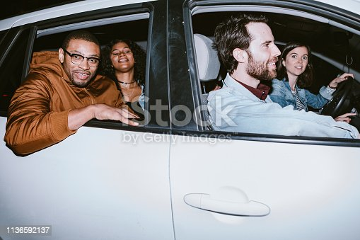 istock Friends Explore Downtown Los Angeles At Night In Shared Car 1136592137