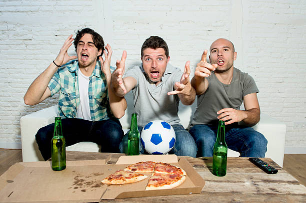 friends fanatic football fans watching television with beer and pizza stock photo