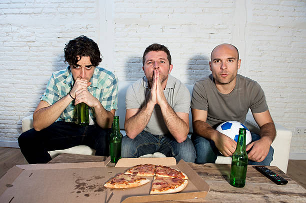 friends fanatic football fans watching tv match stress and nervous - sports championship stock photos and pictures