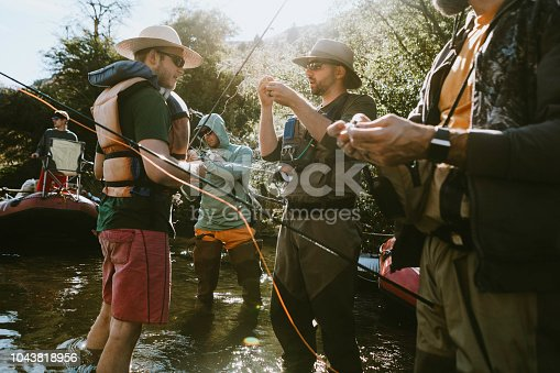 A fun end of summer vacation, a group of men take a casual raft ride on the Deschutes River in Oregon state, enjoying white water rapids and fly fishing.  Three day trip, starting in Warm Springs and pulling out in Maupin.