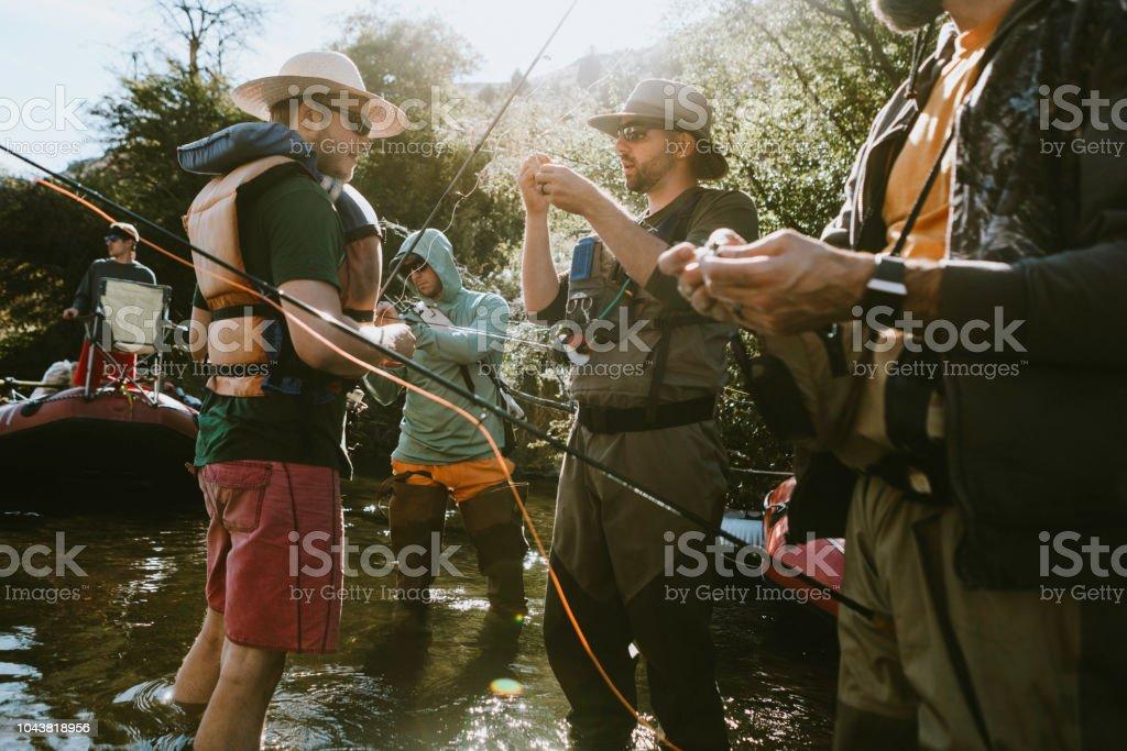 Friends Fishing On Deschutes River Rafting Trip stock photo