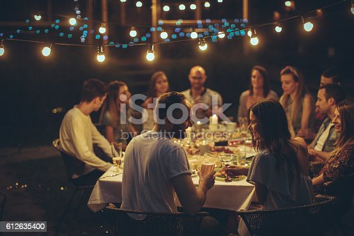 Photo of a cheerful friends having gathering in a local bistro