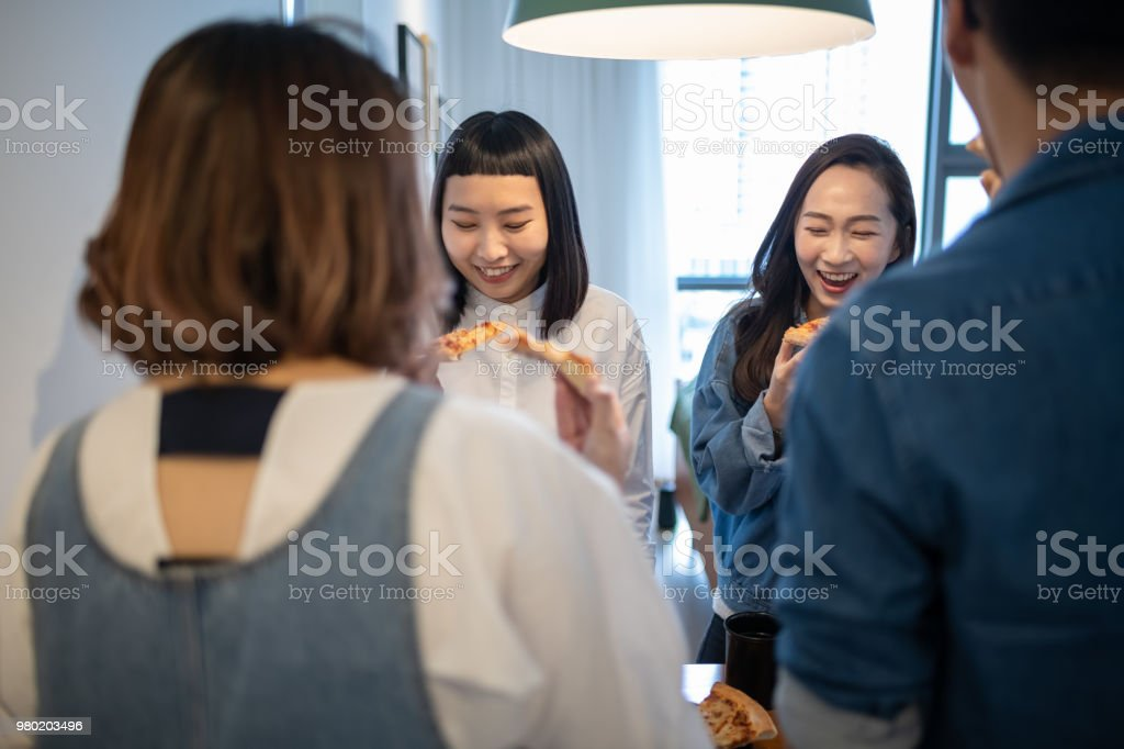 4 friends gathering at home for a quick meal