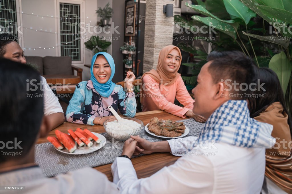friends gathering enjoy the iftar meal in the backyard house