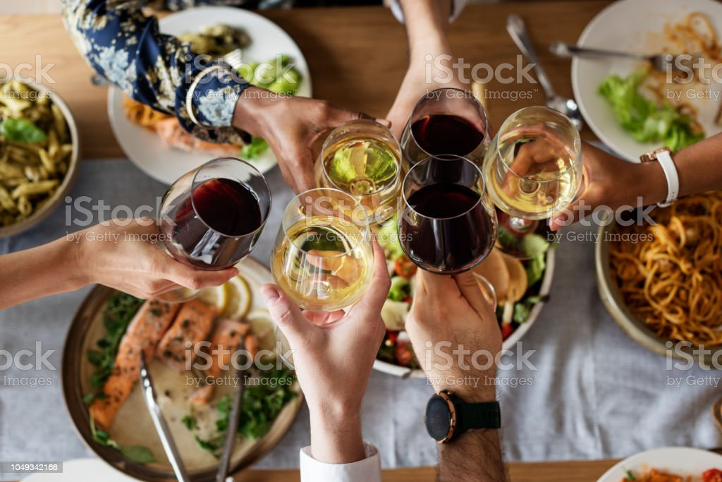 Friends gathering having Italian food together stock photo
