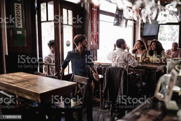 Friends gathering in pub watching a soccer game picture id1193505243?b=1&k=6&m=1193505243&s=612x612&h=ku4mjbh7fdwe34d0urdibayvdno9k3mkskh g1dpofk=