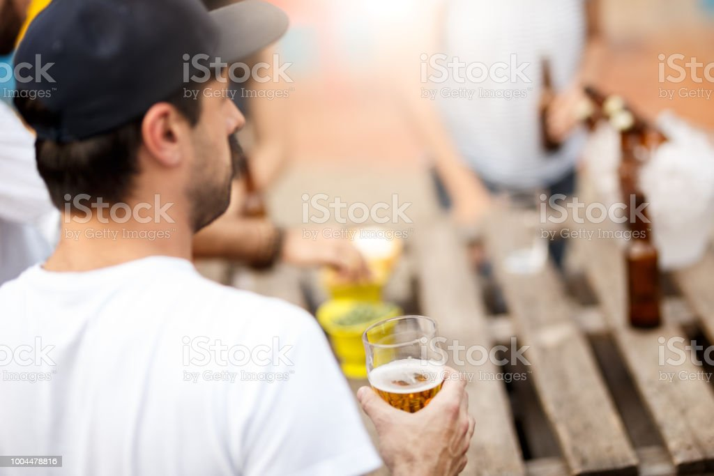 A group of friends having a good time gathering in the rooftop for...