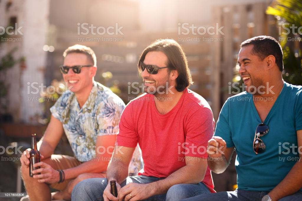 A group of friends having fun gathering in a rooftop for food and...
