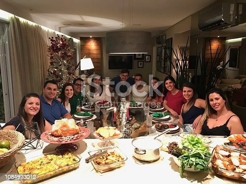 istock Friends get together to enjoy a Christmas dinner - Photo from mobile 1084923012