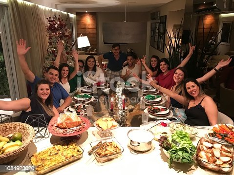 istock Friends get together to enjoy a Christmas dinner - Photo from mobile 1084923020