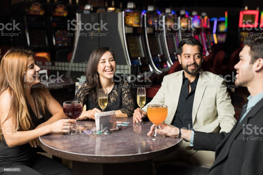 Friends getting drinks in a casino stock photo