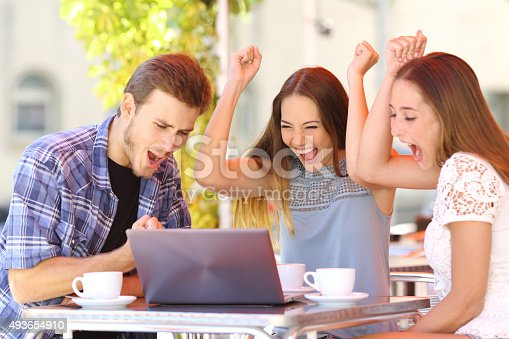 493712130 istock photo Friends giving a laptop gift to a surprised girl 493654910