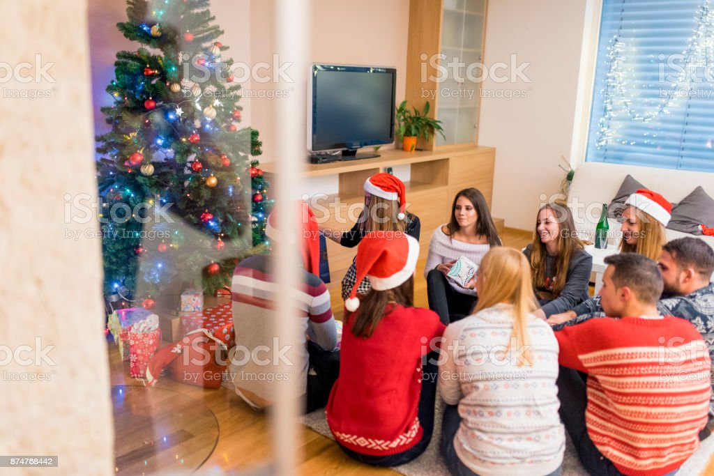 Friends Giving Each Other Christmas Presents Stock Photo