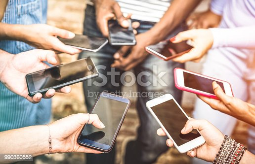 istock Friends group having addicted fun together using smartphones - Hands detail sharing content on social network with mobile smart phone - Technology concept with people millennials online with cellphone 990360552