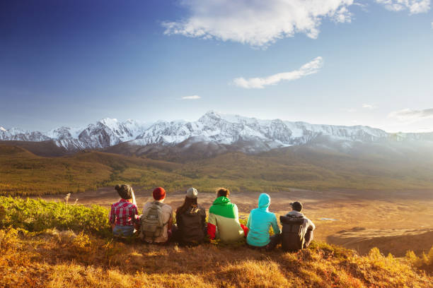 Friends group mountains travel concept stock photo