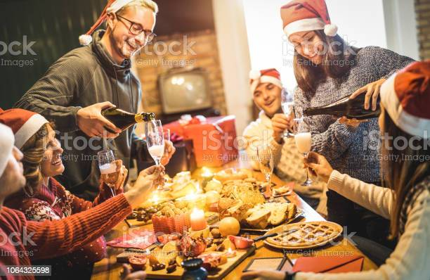 Friends group with santa hats celebrating christmas with champagne picture id1064325598?b=1&k=6&m=1064325598&s=612x612&h=ov veetzs7e3oyuqejcsupoxtfk7mnpbrri by qqwm=