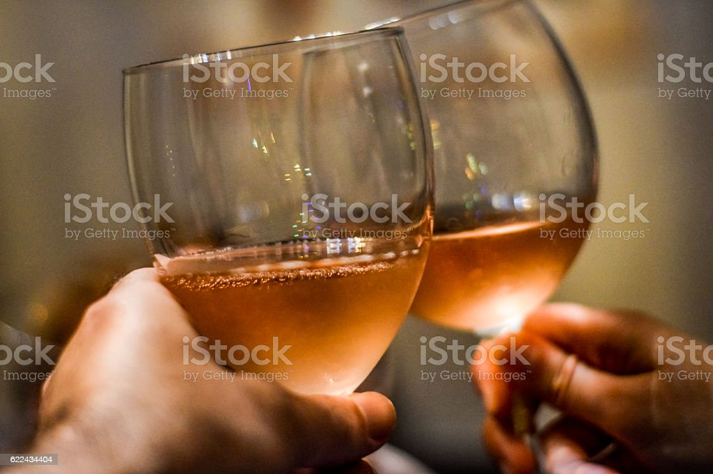 friends hands and glasses toasting close up stock photo