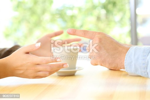 969532194 istock photo Friends hands arguing in a restaurant or home 903237310