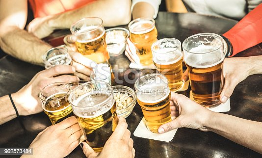 istock Friends hands drinking beer at brewery pub restaurant - Friendship concept with young people enjoying time together and having genuine fun at cool vintage brew bar - Focus on middle right small glass 962573484