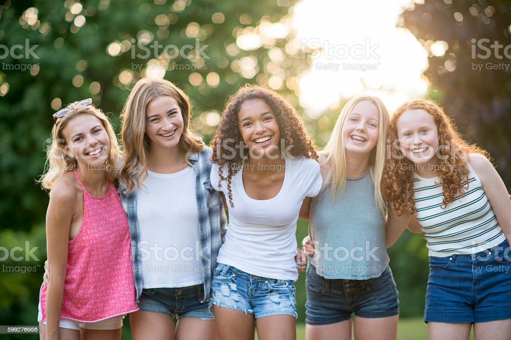 Friends Hanging Out at the Park stock photo
