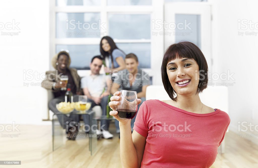 Friends hanging out in a living room royalty-free stock photo